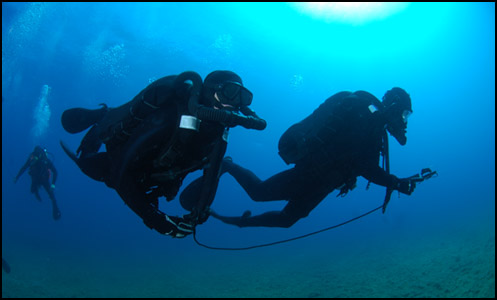 Divers using CRABEs